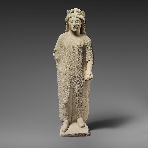 Limestone statuette of a boy