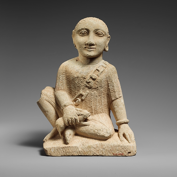Limestone statuette of a temple boy