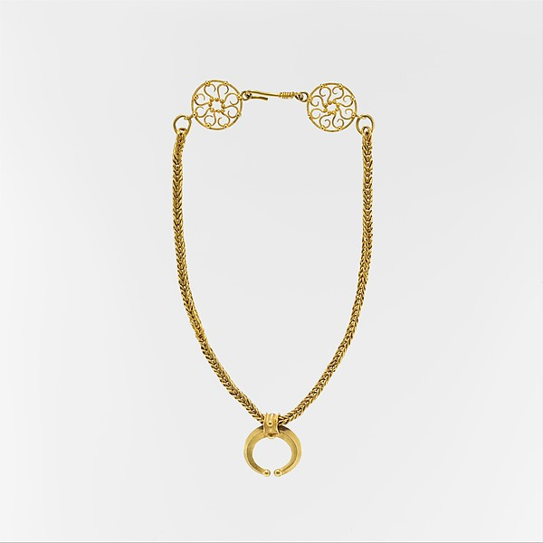 Gold necklace with crescent-shaped pendant