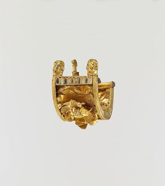 Gold and enamel a baule earring