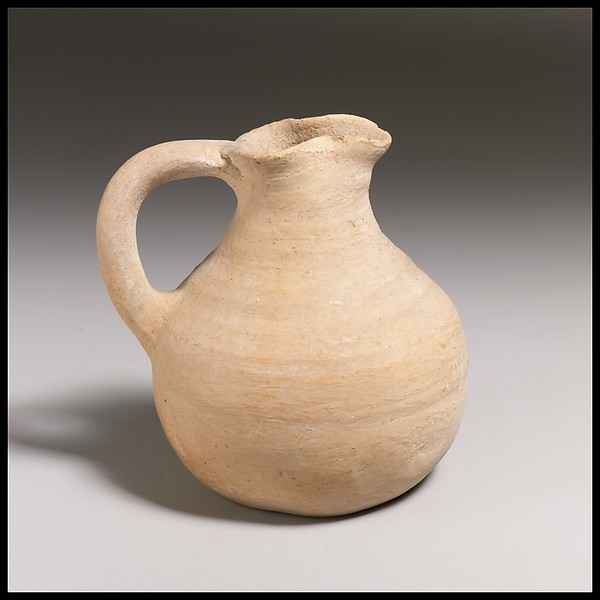 Small terracotta trefoil-mouthed jug