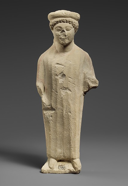 Limestone statuette of a boy with a flat headdress