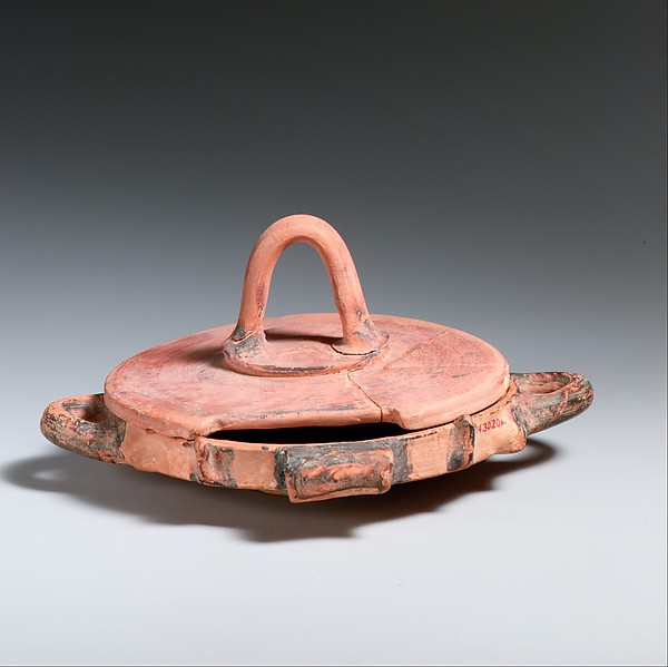 Shallow terracotta dish with lid
