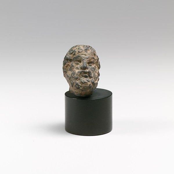 Bronze head of a bearded man or god