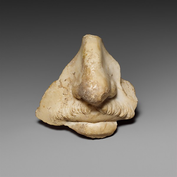 Fragment from a marble head of a man, preserving the nose and mouth