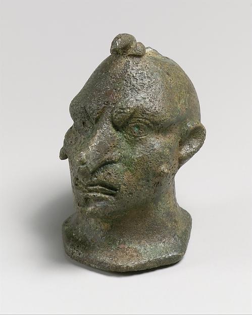 Bronze head of a grotesque