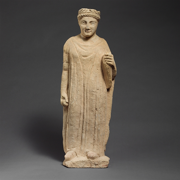 Limestone statuette of a boy holding a bird