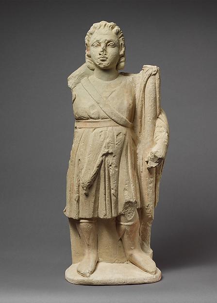 Limestone statuette of Dionysos holding a thyrsos