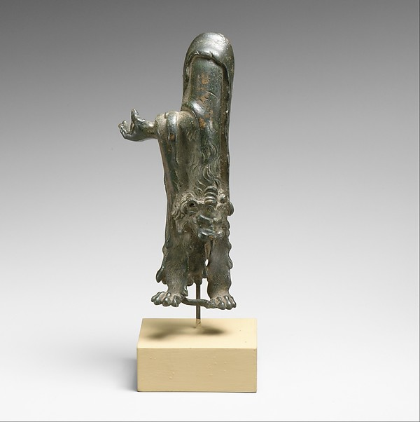 Fragmentary bronze statuette of Herakles with lion's skin