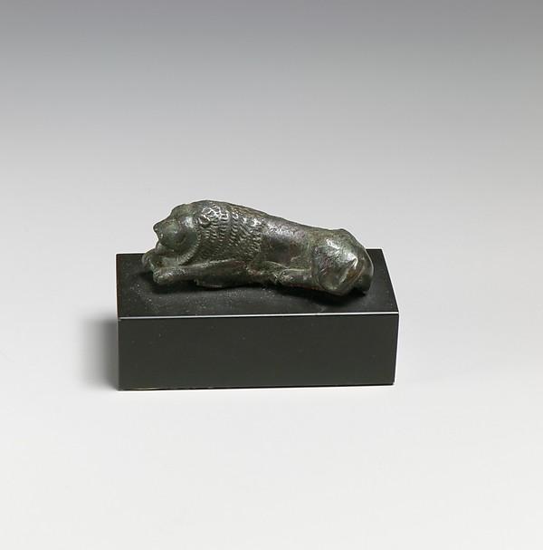 Bronze statuette of a recumbent lion