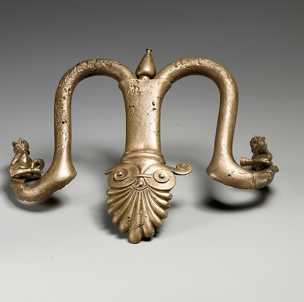 Handles and feet of a bronze louterion (basin)