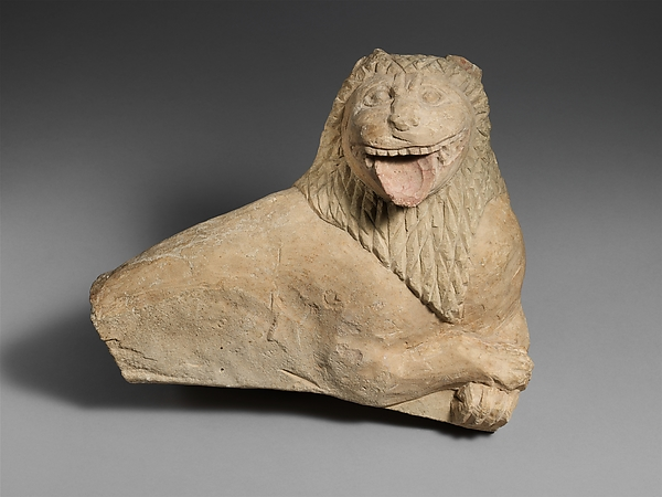 Fragment of a limestone funerary stele with a recumbent lion