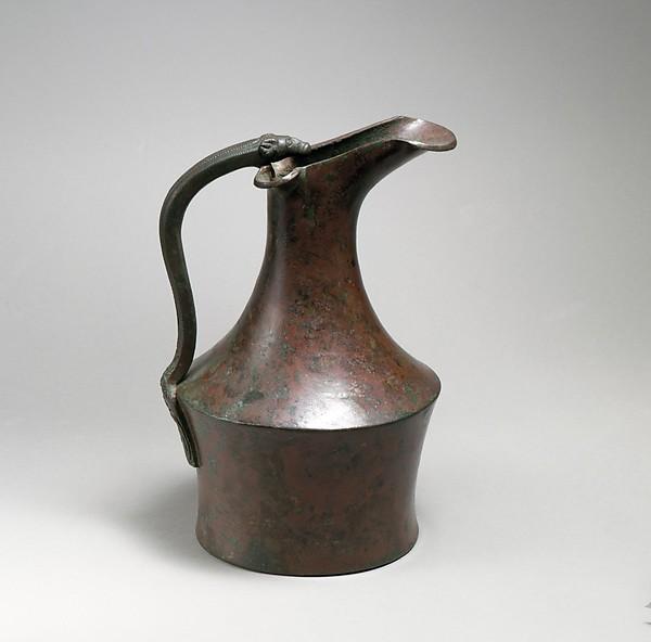 Bronze oinochoe (jug) and handle attachment