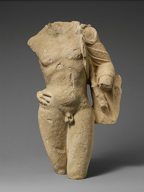 Fragment of a limestone statuette of Pan
