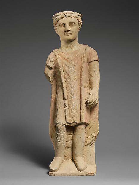 Limestone statuette of a boy holding a pyxis