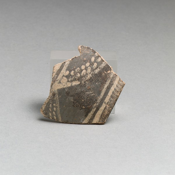 Terracotta rim fragment with bands and dots