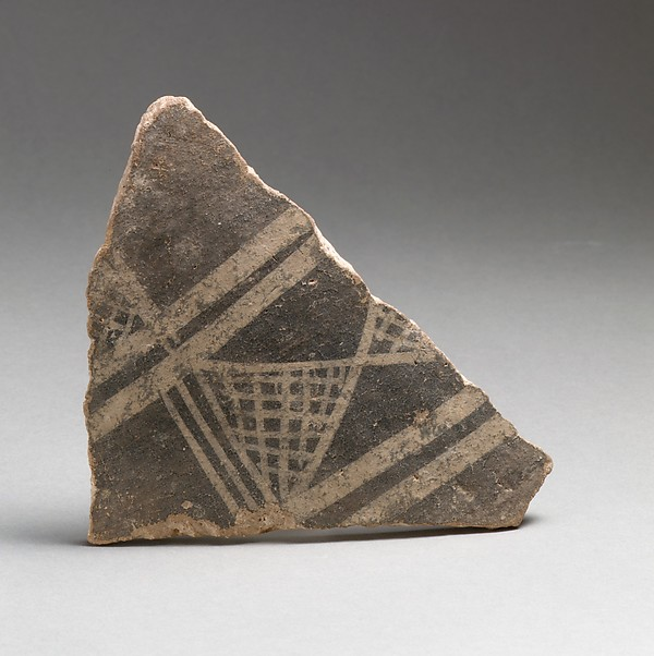 Terracotta vessel fragment with cross-hatched triangles and broad bands