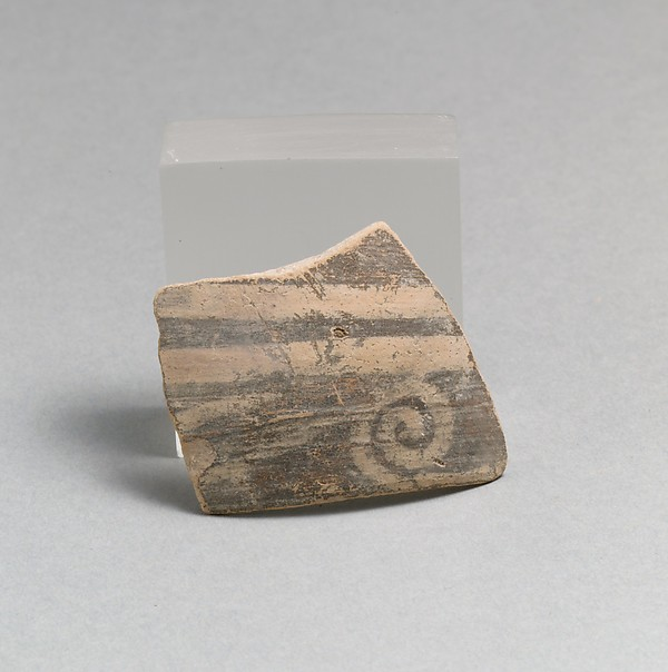 Terracotta rim fragment with running spiral
