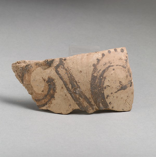 Terracotta vessel fragment with floral motif