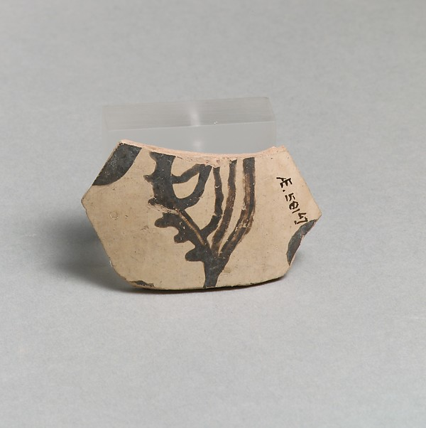 Terracotta vessel fragment with marine motif
