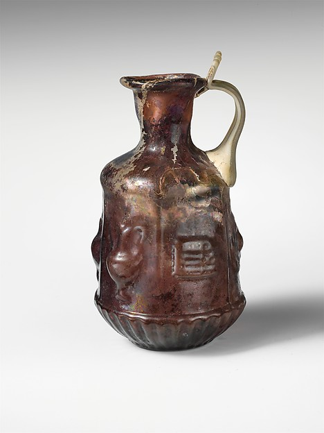 Glass hexagonal jug with Dionysiac symbols
