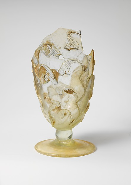 Fragmentary glass beaker with snake-thread decoration