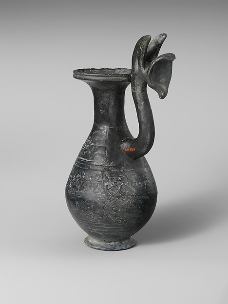 Terracotta jug with griffin protome handle