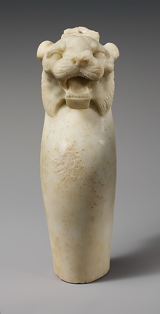 Marble leg of a table with a tiger's head