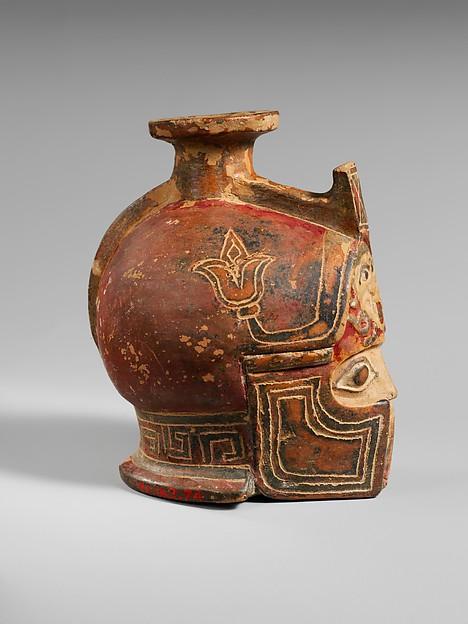 Terracotta aryballos in the form of a helmeted head