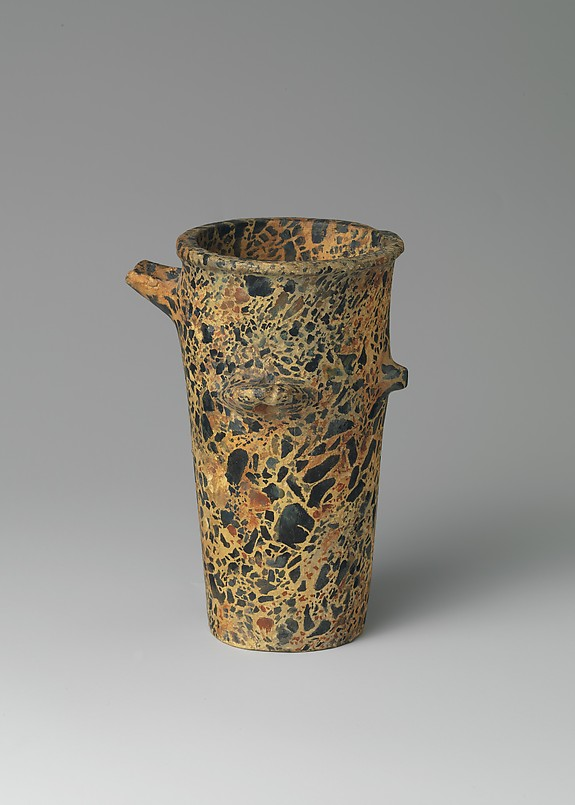 Reproduction of a tall spouted breccia stone vase