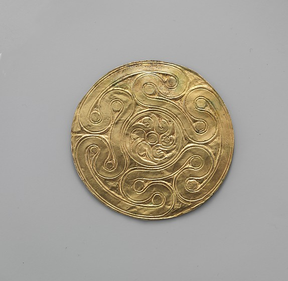 Reproduction of a gold disk ornament with spirals
