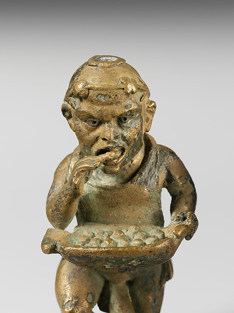 Bronze statuette of a dwarf with silver eyes