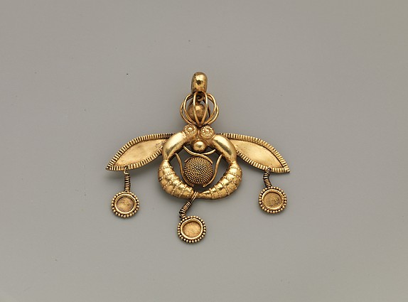 Reproduction of a gold bee pendant