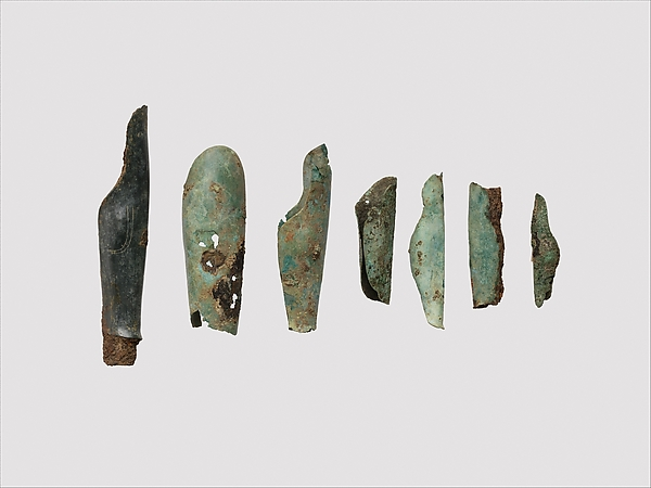 Miniature bronze greave