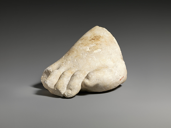 Part of the left foot of a colossal marble statue