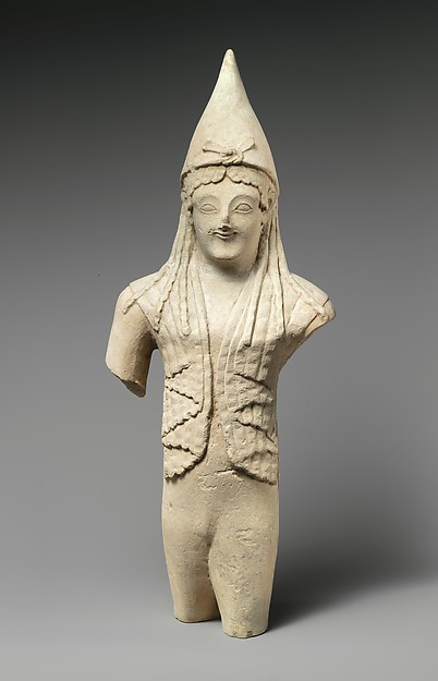 Limestone statuette of a youthful votary wearing a pointed cap