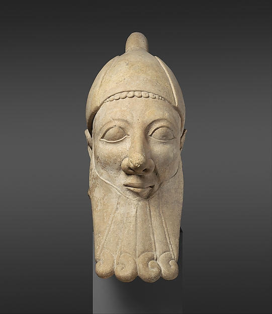 Limestone head of a bearded man