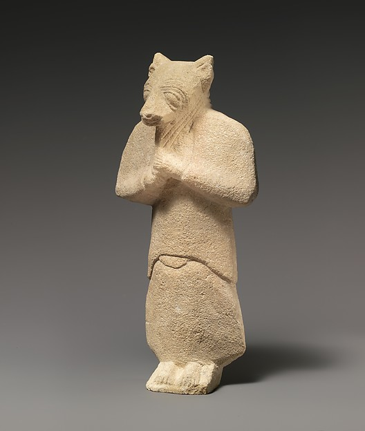 Limestone figure wearing a mask