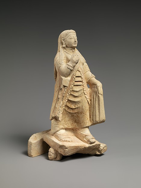 Limestone figure of a woman
