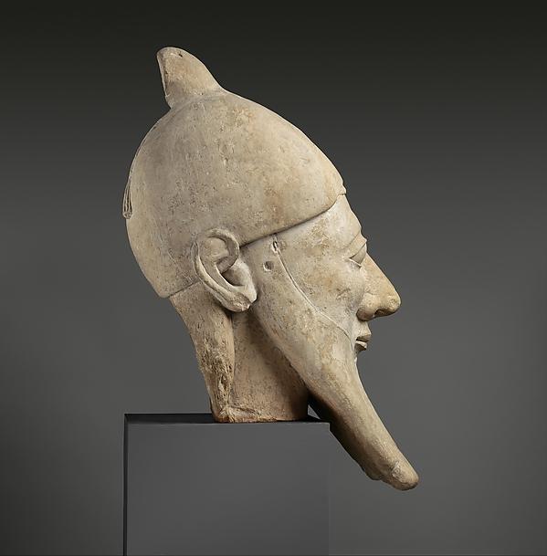 Limestone head of a bearded man