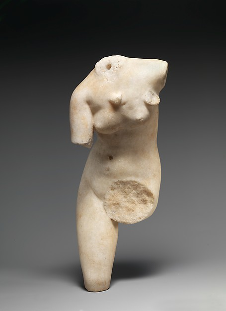 Marble statue of Aphrodite loosening her sandal