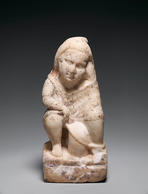 Marble statuette of a slave boy with a lantern