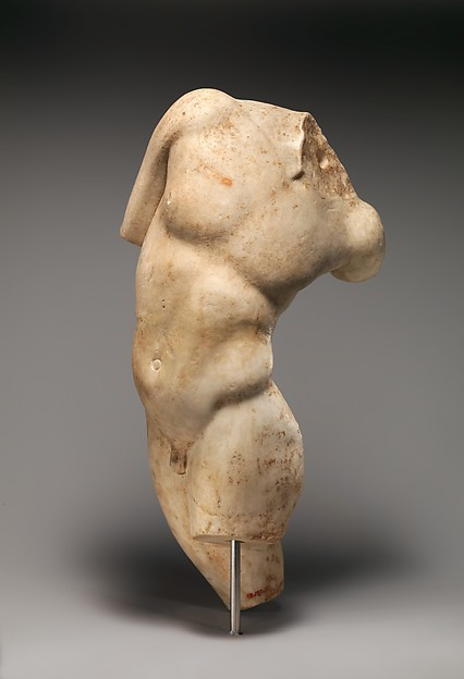 Marble statue of a young satyr turning to look at his tail