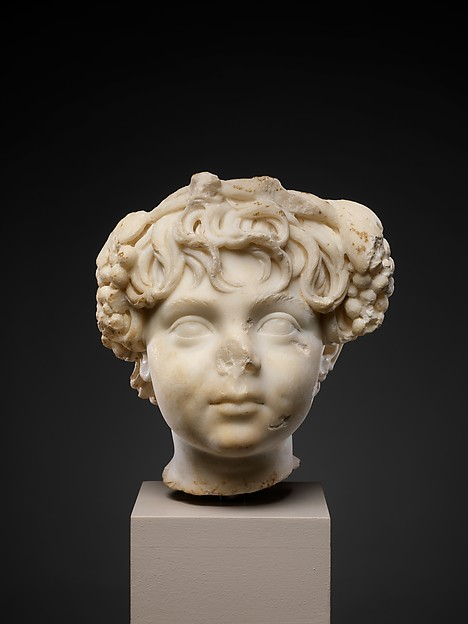 Marble head of a boy wearing a wreath