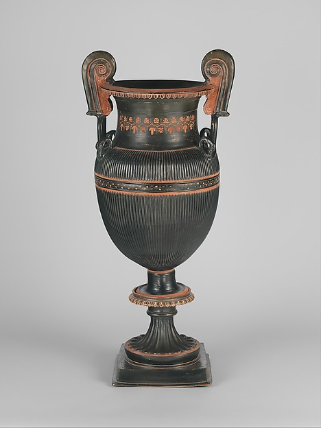 Pair of terracotta volute-kraters (vases for mixing wine and water) with stands