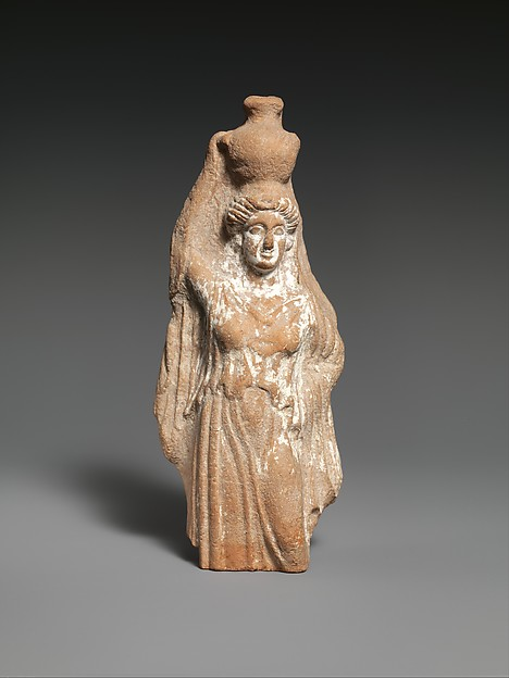 Terracotta statuette of a female votary carrying a hydria