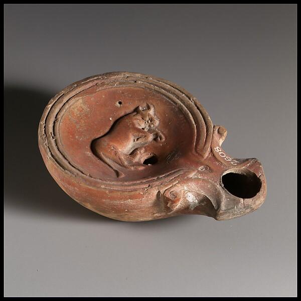 Terracotta lamp: on discus, bull