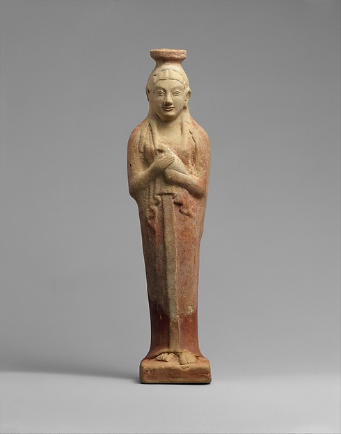 Terracotta alabastron (perfume vase) in the form of a woman holding a dove