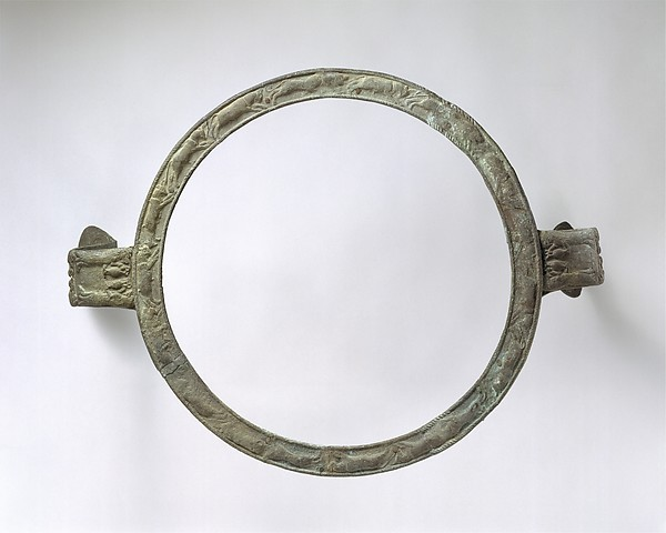 Bronze handles and rim of a cauldron