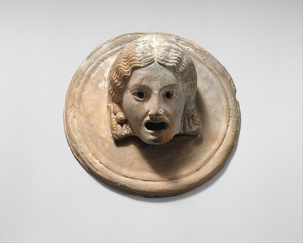 Two terracotta roundels with theatrical masks